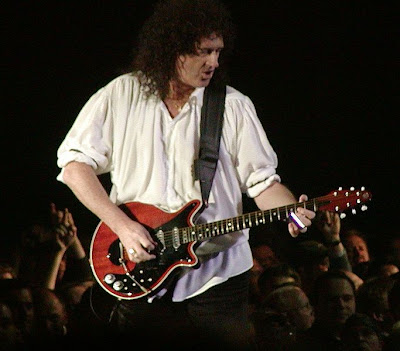 Brian May of Queen playing guitar live