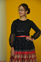 Aditi Myakal in Spicy Red Short Skirt and Transparent Black Top at at Big FM For Promotion of Movie Ami Tumi 067.JPG