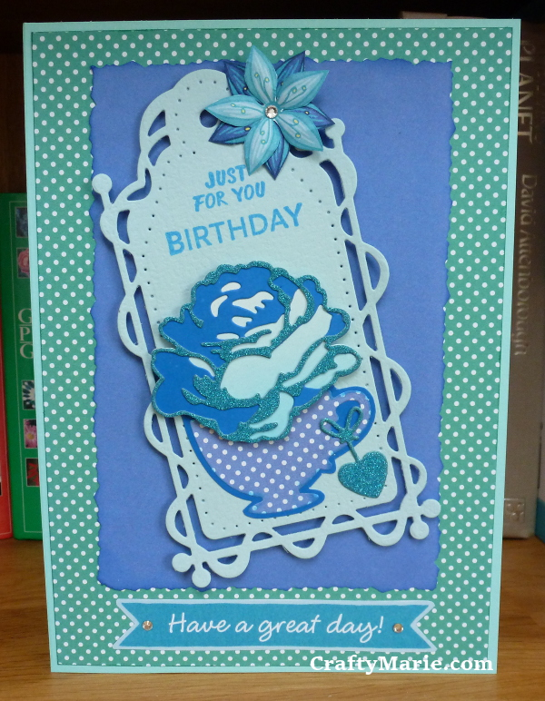 Blue green polka dot floral tag card with die cut tag, flowers and tea cup handmade by craftymarie