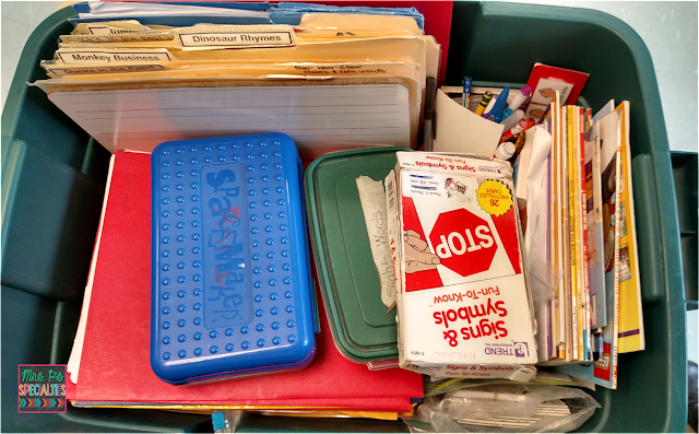 photo of inside the work center bucket. It's filled with folders of IEP tasks, data sheets and the materials to complete the tasks