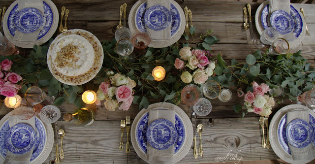 Blue and white dishes on table top for Galentines Day setting