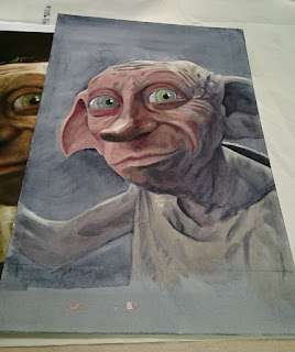 Putting the oil paint down over the underpainting of Dobby from Harry Potter. Artwork by Robin Springett
