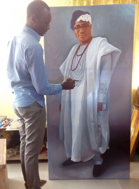 Nigerian visual artists Ayeola Ayodeji painting lifesize oil on canvas portrait painting 3ft by 6ft height.