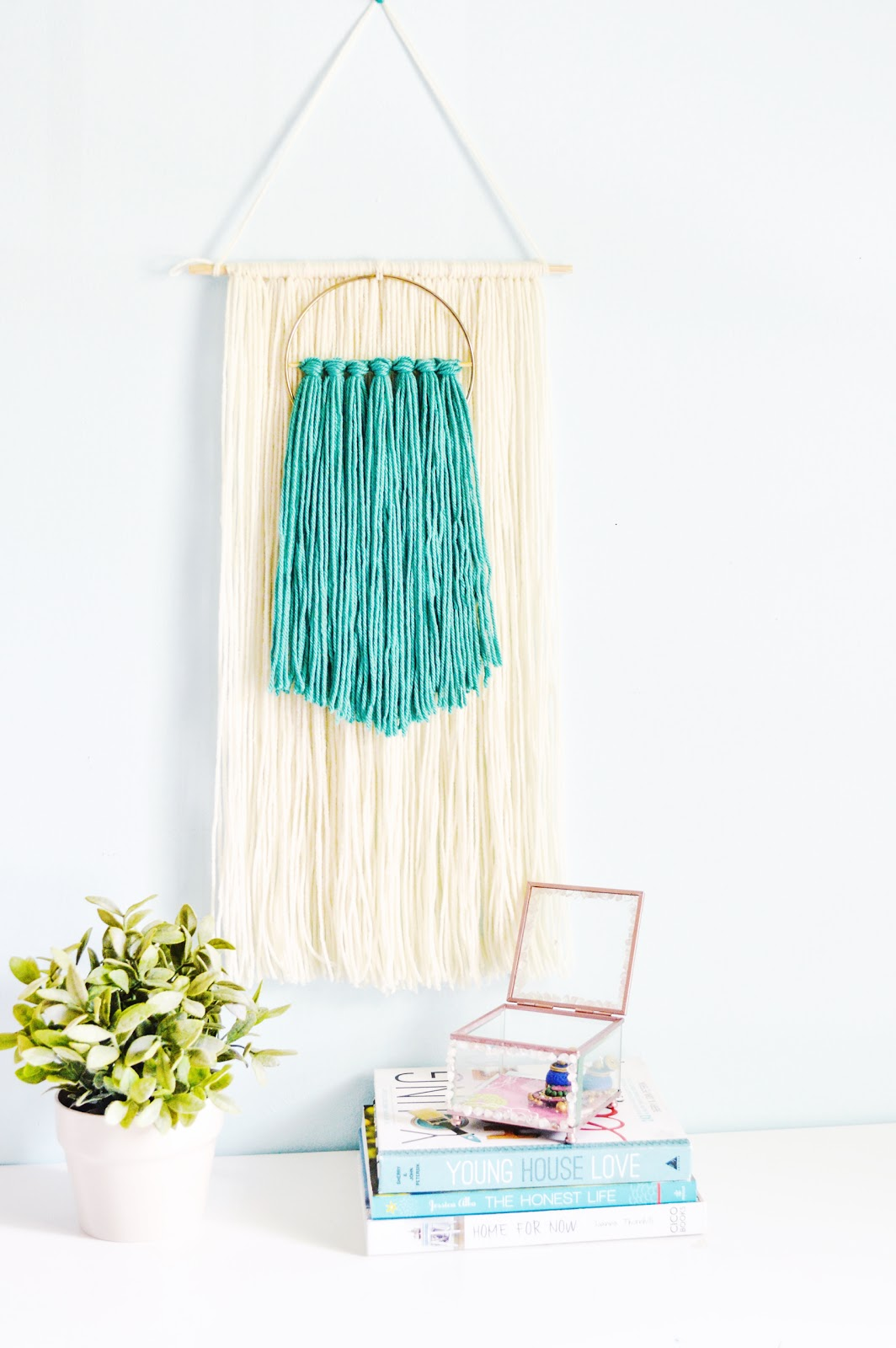 yarn wall art diy with wood dowels and gold hoops