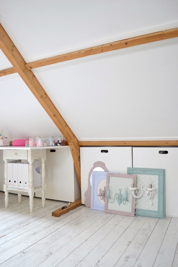 Hidden storage in attic craft room