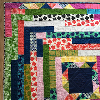 close up of corner of quilt, detail of graphic shapes on fabric