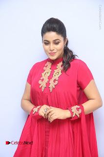 Actress Poorna Latest Stills in Red Dress at Rakshasi First Look Launch  0040.JPG