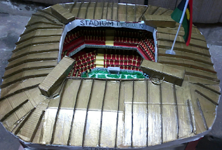 Boy Constructs Stadium With Paper