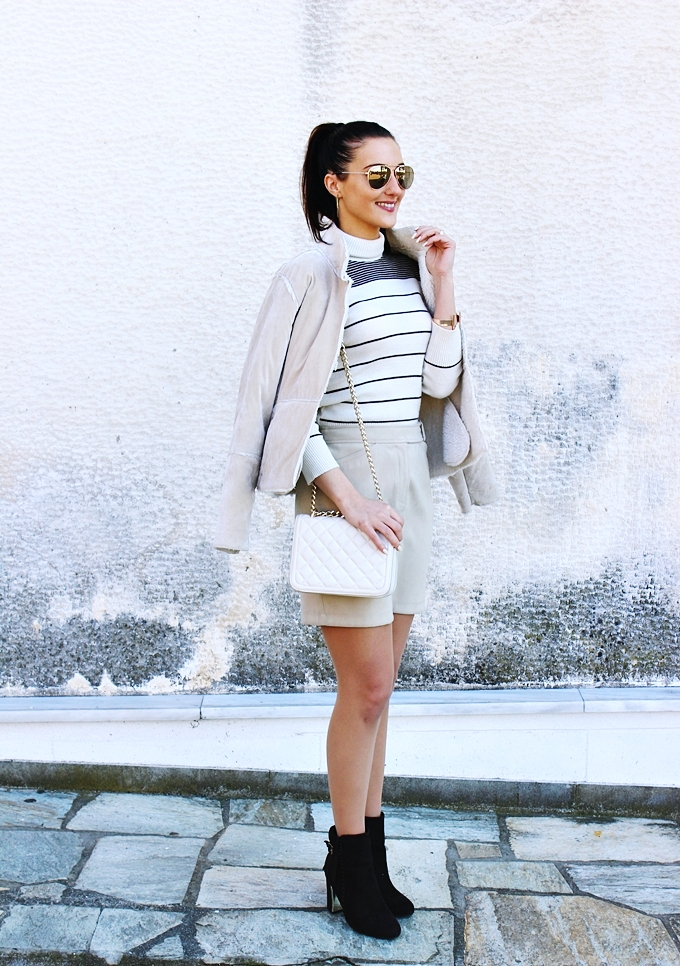Mexx mini skirt.Beige striped turtleneck.Zara chain purse.Beige shearling jacket.Fashion Mark brown booties.H&M sunglasses, earrings and cuff.