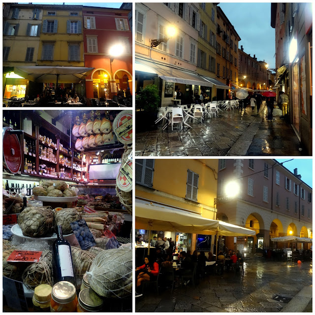 Cafe terraces and gourmet food shops in Parma, Italy