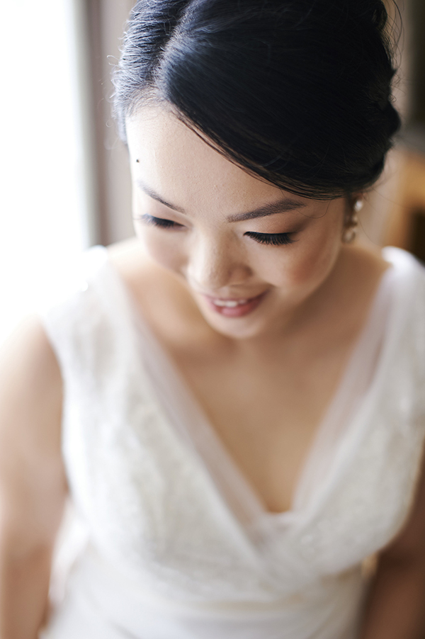Natural-looking bridal makeup with faux lashes by Esquido and a braided updo