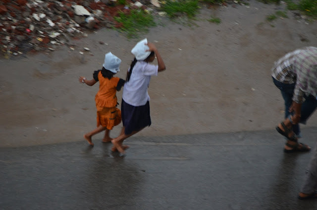 kids running in rains during monsoon