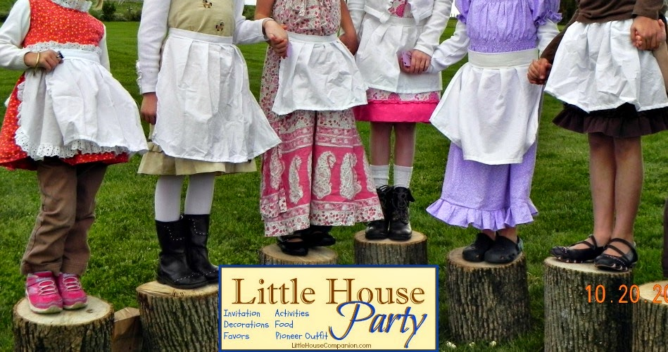 Pioneer aprons on Little House party guests.