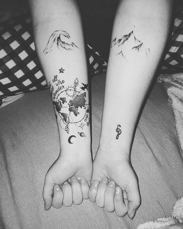 beautiful earth tattoo on hands