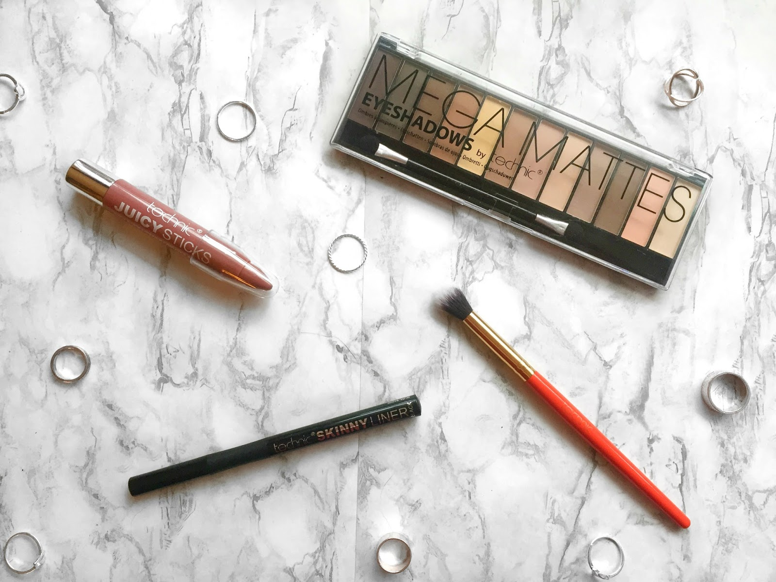Everyday Basics from Technic including Nude Eyeshadow Palette, Felt Liquid Liner Pen, Jumbo Lip Crayon and Eyeshadow Blending Brush.