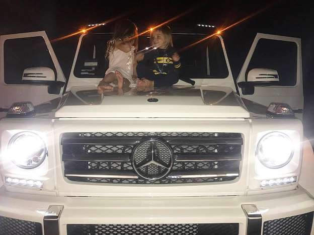 Kourtney Kardashian Criticized for Sharing Photos of Her Children on Hood of $122,000 Car