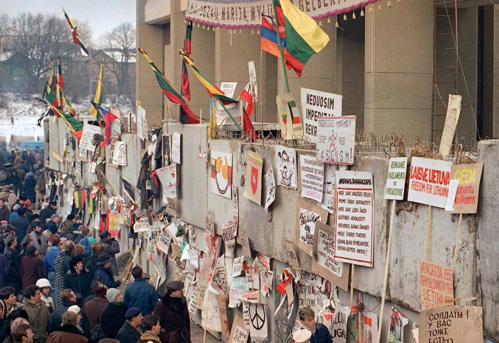 Anti-Soviet political graffiti filled an entire wall in Vilnius on January 17, 1991. The wall surrounding the Lithuanian parliament was erected to defend against a possible raid by Soviet troops. Many Soviet army deserters pinned their draft cards to a defaced poster of President Mikhail Gorbachev.