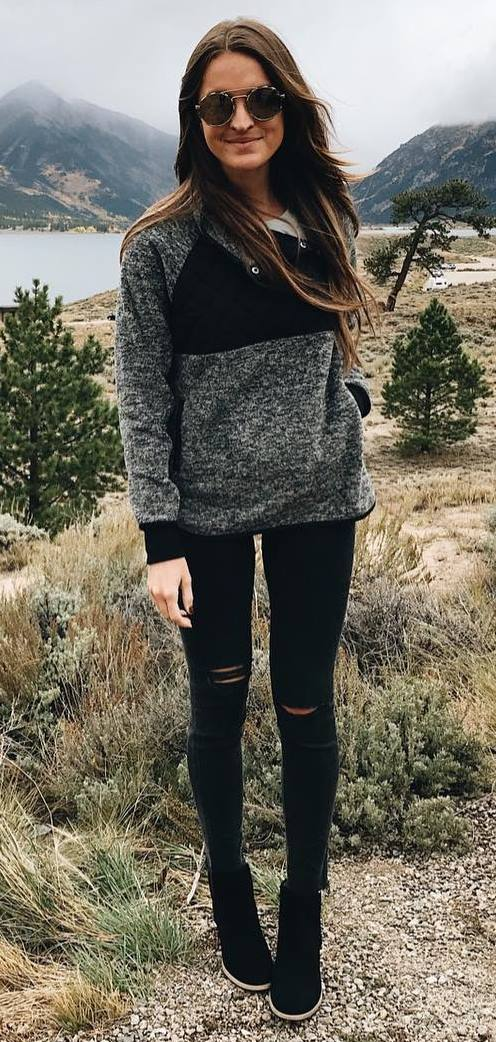 trendy fall outfit / sweater + rips + boots