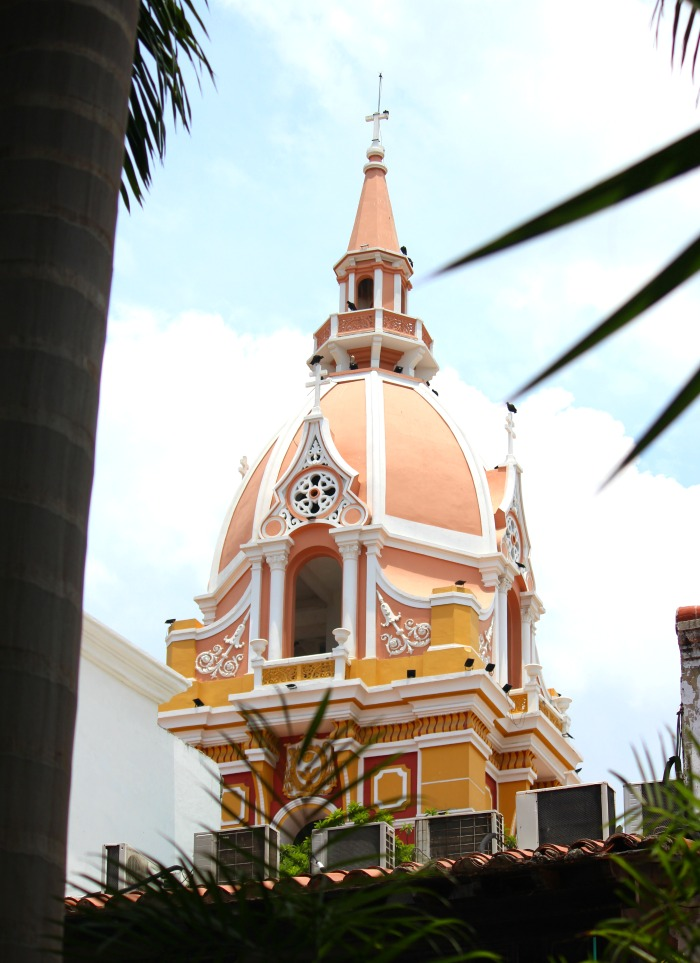 blue skies and bright buildings in cartagena colombia