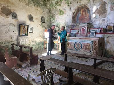 Cava D'Ispica - Talking to the custodian inside Chiesetta Rupestre di Santa Maria della Cava.
