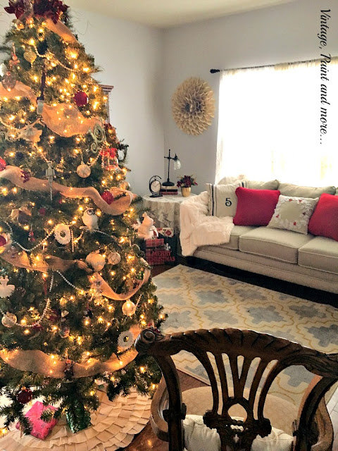 living room view with Christmas tree, stenciled pillows, sweater pillows, felt wreath pillow