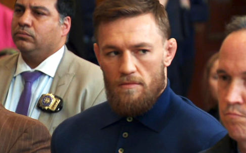 Handcuffed Conor McGregor Appears in Court on Assault, Criminal Mischief Charges in UFC Melee