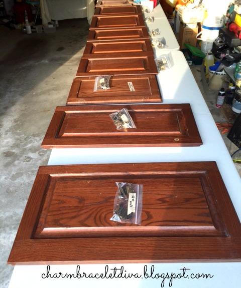 dark mahogany kitchen cabinet doors in garage pre-painting