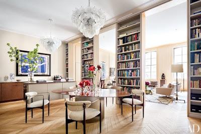 Chevron floor in home decor living room with tall bookshelves