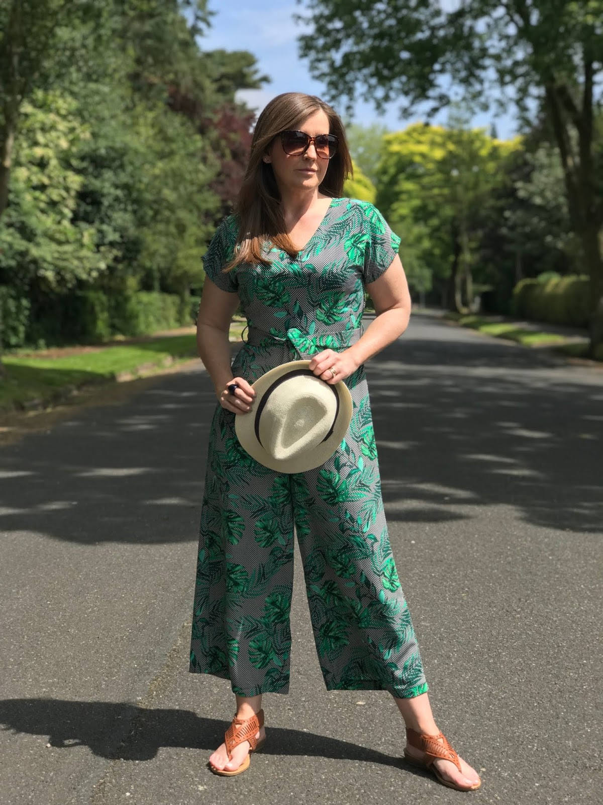 Green Primark pal leaf jumpsuit \ tie belt \ trilby hat \ brown sandals