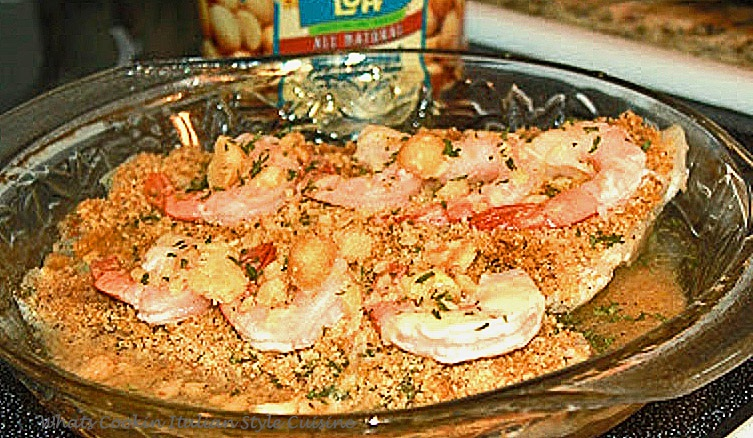 this is a seafood dish called flounder with macadamia nuts topped with shrimp white wine, breadcrumbs and butter