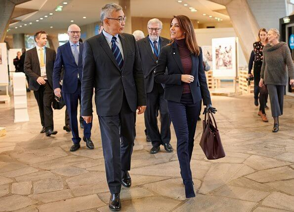 Princess Marie has been Patron of the Danish Unesco National Commission since 2009. Ralph Lauren bag and black blazer
