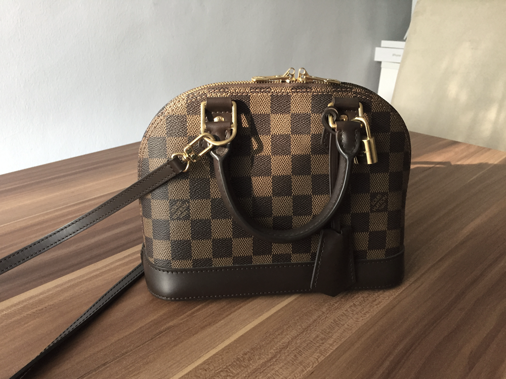 c1786e27f96c Today I wanted to sit down and have a chat about my Louis Vuitton Alma BB  in Damier Ebene that I got in January of 2016. Basically just let you know  any ...