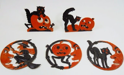 Black cats and Jack O'Lanterns and quarter moon pieces with witch, pumpkin goblin, and arched cat.