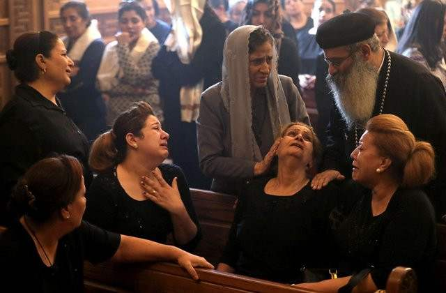 Some Christians in Egypt weep uncontrollably as seven dead members killed in militant attack are buried. Six of the dead from same family.
