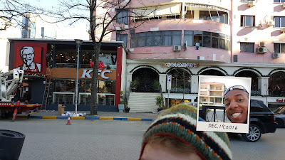 Me and former house of Enver Hoxha, communist prime minister who ruled 40+ years (small photo)  Kentucky Fried Chicken restaurant (large photo) Communism and Capitalism faceoff