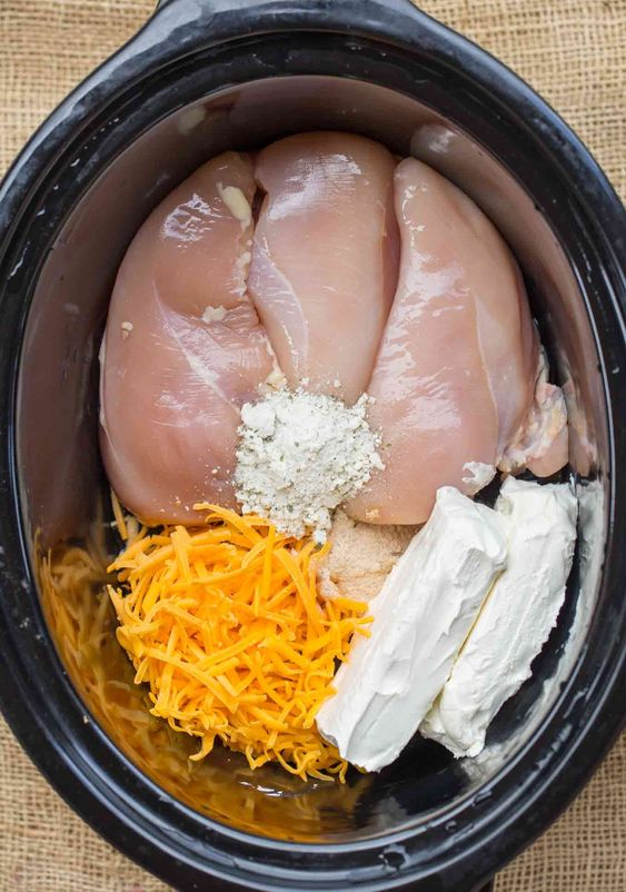 """Slow Cooker Chicken Bacon Ranch Sandwiches, also sometimes referred to as """"crack chicken"""" are made with bacon, cream cheese, chicken, cheddar cheese and ranch seasonings and they're a family favorite!"""