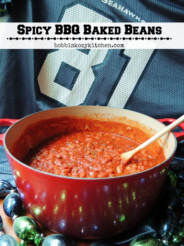 "This spicy BBQ baked beans recipe brings just enough heat to wake your tastebuds up and say ""Go Team!"". #football #Tailgate #homegate #sidedish #party #BBQ #beans #spicy #recipe 