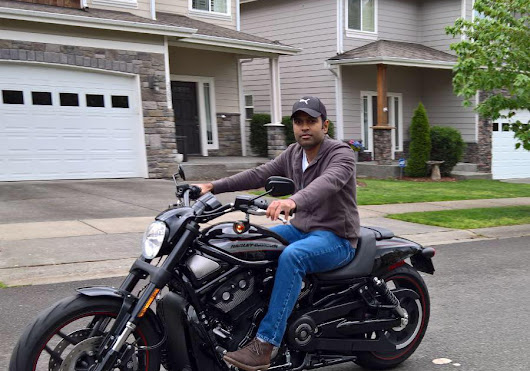 Ronnie on Benzy's Harley Davidson When he Visited Them