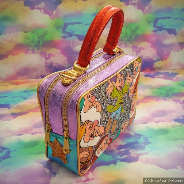 angled bag sitting on rainbow cloud background showing metallic sides