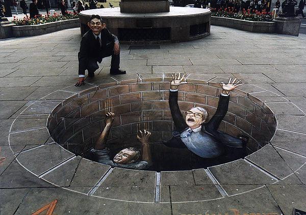 Kuyuya düşen insanları gösteren kaldırım sanatı resmi