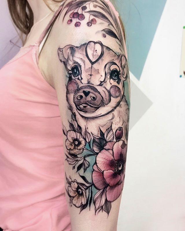 full arm pig tattoo