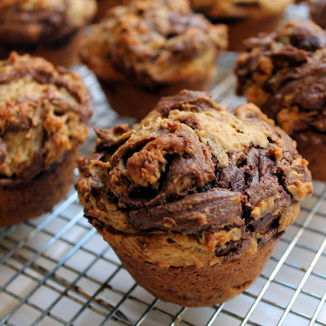 A soft and moist peanut butter muffin with swirls of Nutella. Peanut Butter Nutella Muffins are what muffin heaven looks like!