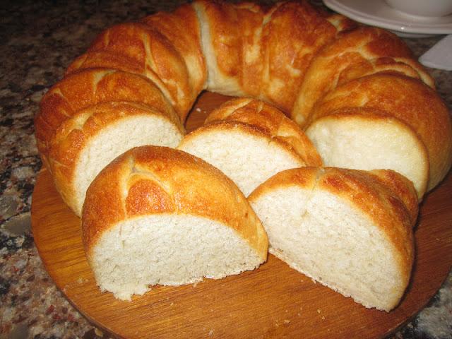 Homemade Italian Bread sliced on a cutting board from Walking on Sunshine.