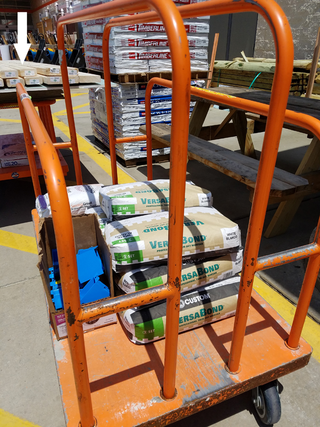 Home Depot cart with materials for bath makeover