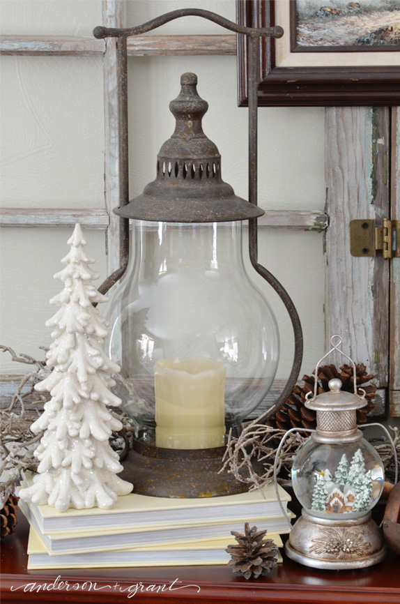 Winter vignette on the fireplace mantel | www.andersonandgrant.com