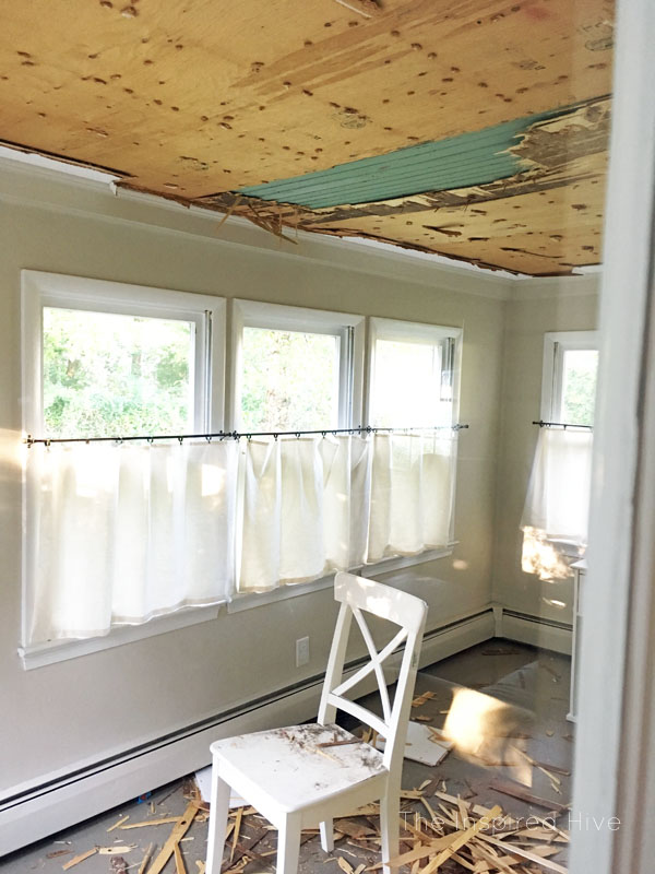 We found a concealed haint blue porch ceiling in our old farmhouse!