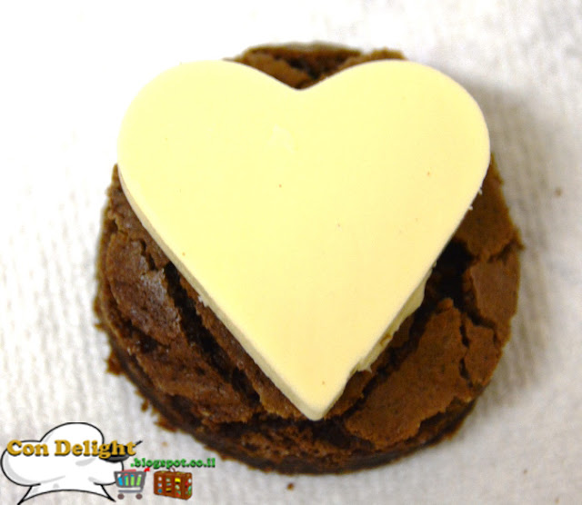 heart-shaped white chocolate on top of brownie