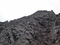 Mountain Goat climbing Pyramid Peak in the Elks