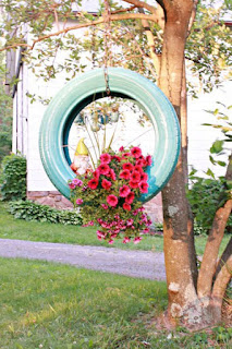 Make a wonderful decoration for your yard by using old tire like a hanging flower planter. You can paint in your favorite color or you can decorate with your own idea.