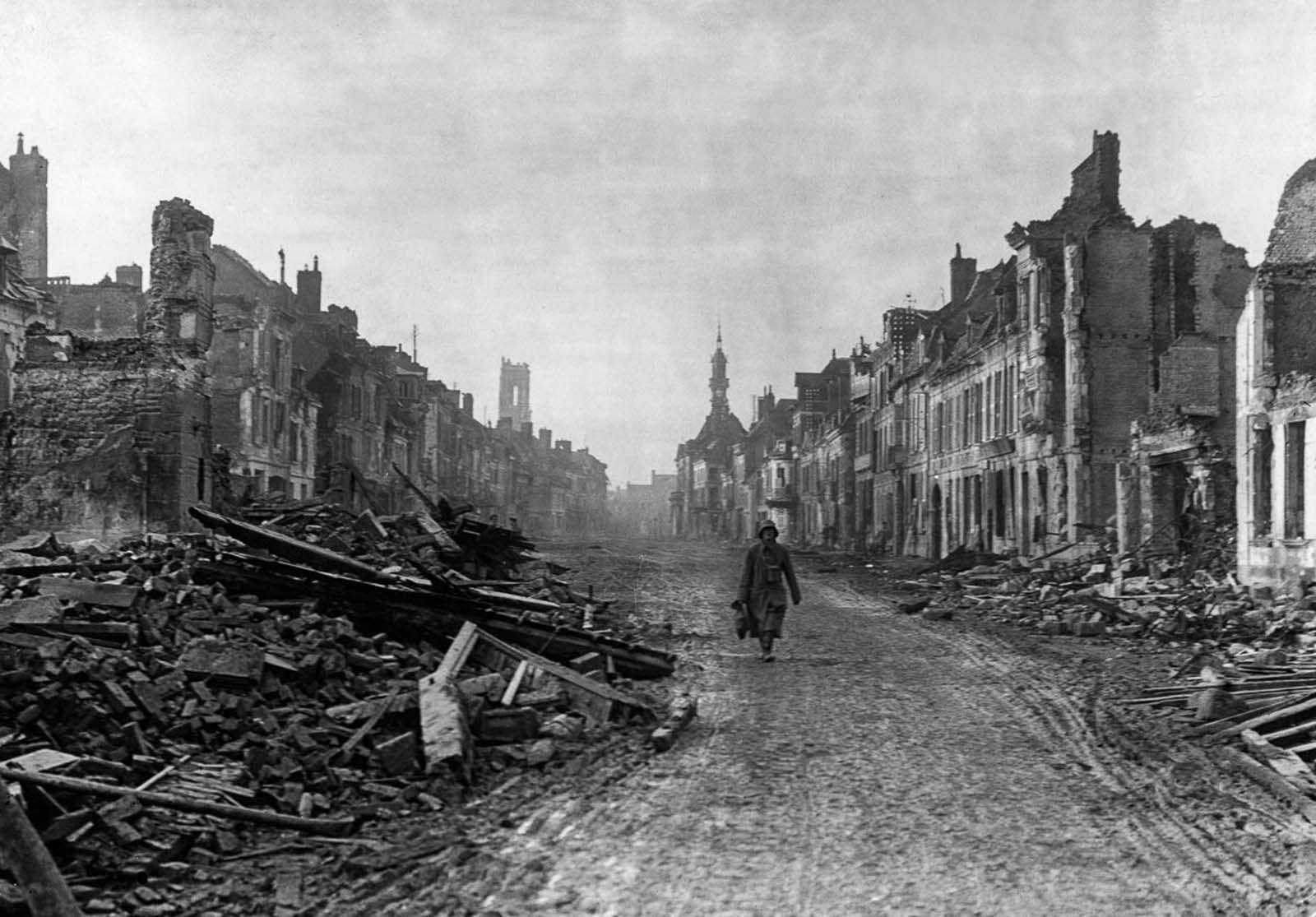 A German soldier walks through the ruined streets of Peronne. November, 1916.
